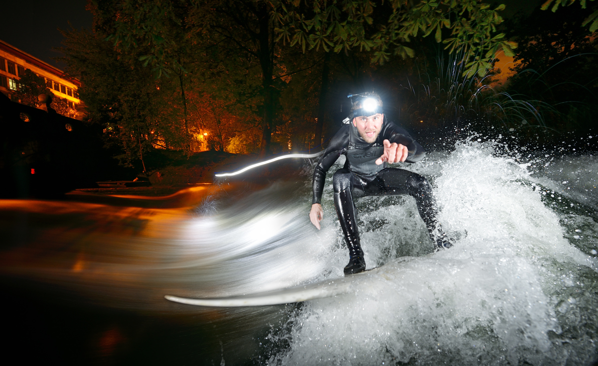 Night surfing on the Eisbach, Munich